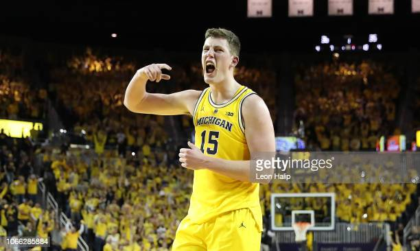 Jon Teske of the Michigan Wolverines reacts to a three point shot made in the first half of the game against the North Carolina Tar Heels at Crisler...