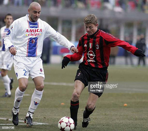 Jon Tomasson of Milan and Stefano Torrisi of Bolgna in action during the Serie A match between AC Milan and Bologna at the Guiseppe Meazza San Ciro...