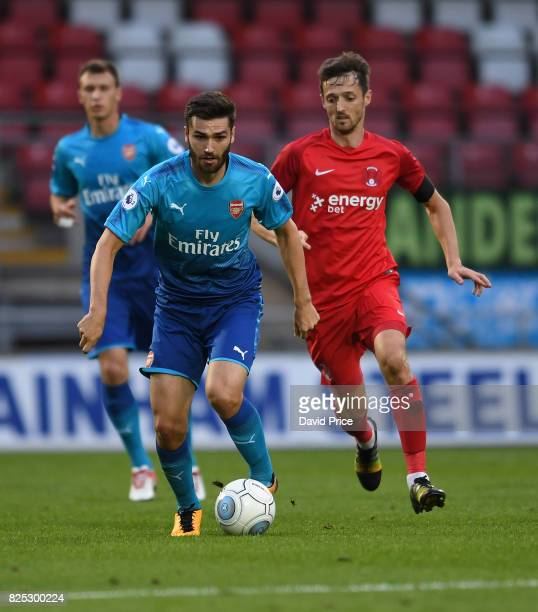 Jon Toral of Arsenal takes on David Mooney of Leyton Orient during the match between Leyton Orient and Arsenal U23 at Brisbane Road on August 1 2017...