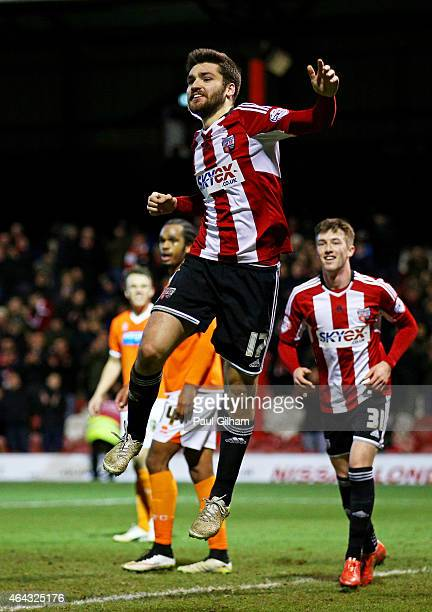 Jon Torl of Brentford celebrates after completing his hattrick by scoring his team's fourth goal during the Sky Bet Championship match between...