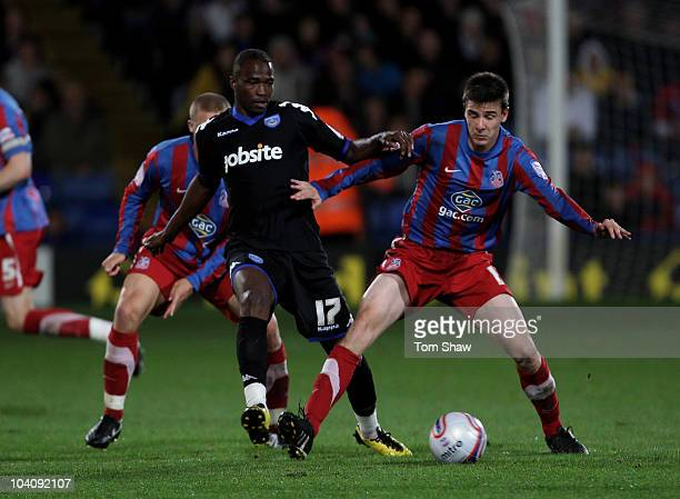 Jon Utaka of Portsmouth tussles with Andrew Dorman of Palace during the npower Championship match between Crystal Palace and Portsmouth at Selhurst...