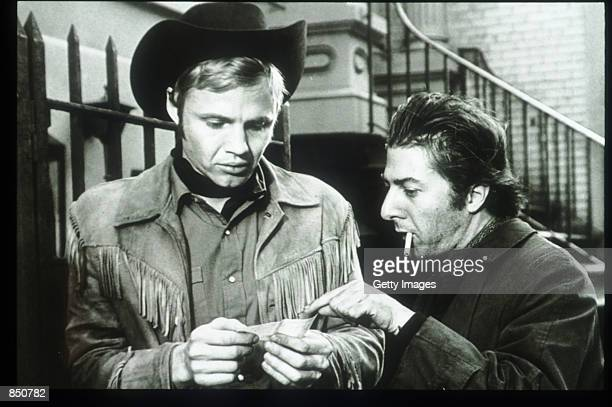 Jon Voight and Dustin Hoffman pose in a still from the film Midnight Cowboy June 15 1968 in the USA The film was the first studio production to...