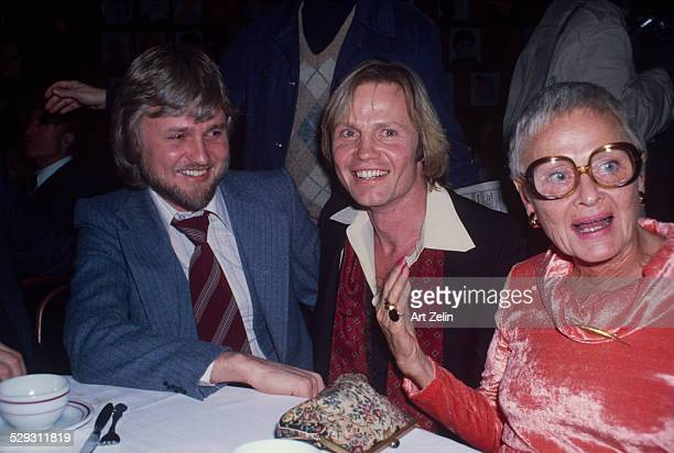 Jon Voight wearing a red silk scarf with his mother Barbara Voight at Sardi's circa 1970 New York
