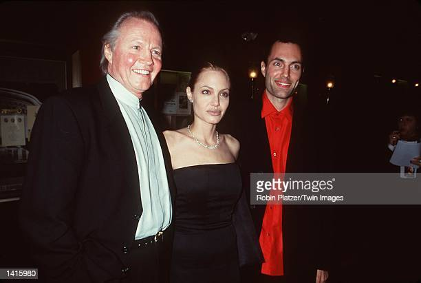 Jon Voight with daughter and son Angelina Jolie and James Haven attend the premiere of 'The Bone Collector' October 28 New York