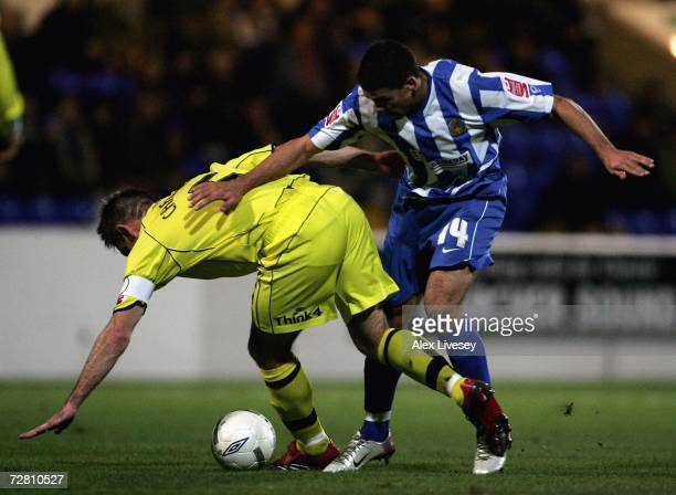 Jon Walters of Chester City is tackled by Dave Challinor of Bury during the FA Cup 2nd round replay match between Chester City and Bury at the...