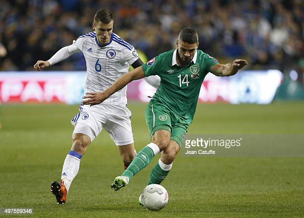 Jon Walters of Ireland and Ognjen Vranjes of Bosnia and Herzegovina in action during the UEFA EURO 2016 qualifier playoff second leg match between...