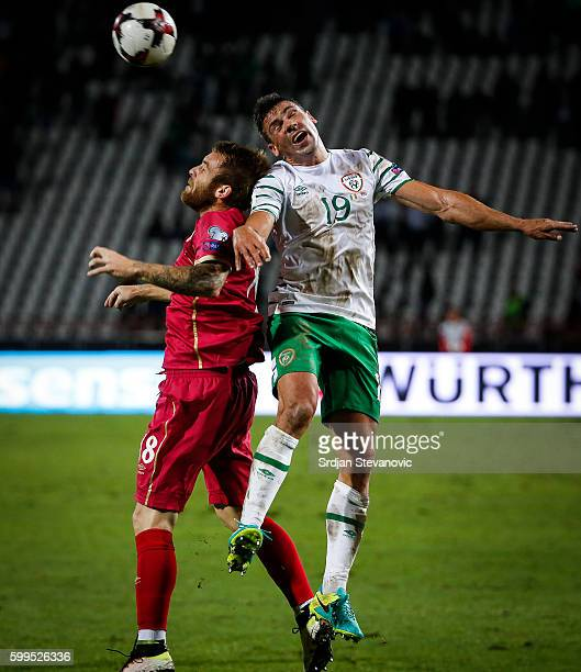 Jon Walters of Ireland jump for the ball against Aleksandar Katai of Serbia during the FIFA 2018 World Cup Qualifier between Serbia and Ireland at...