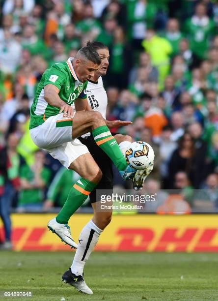 Jon Walters of Republic of Ireland and Sebastian Prodi of Austria during the FIFA 2018 World Cup Qualifier between Republic of Ireland and Austria at...