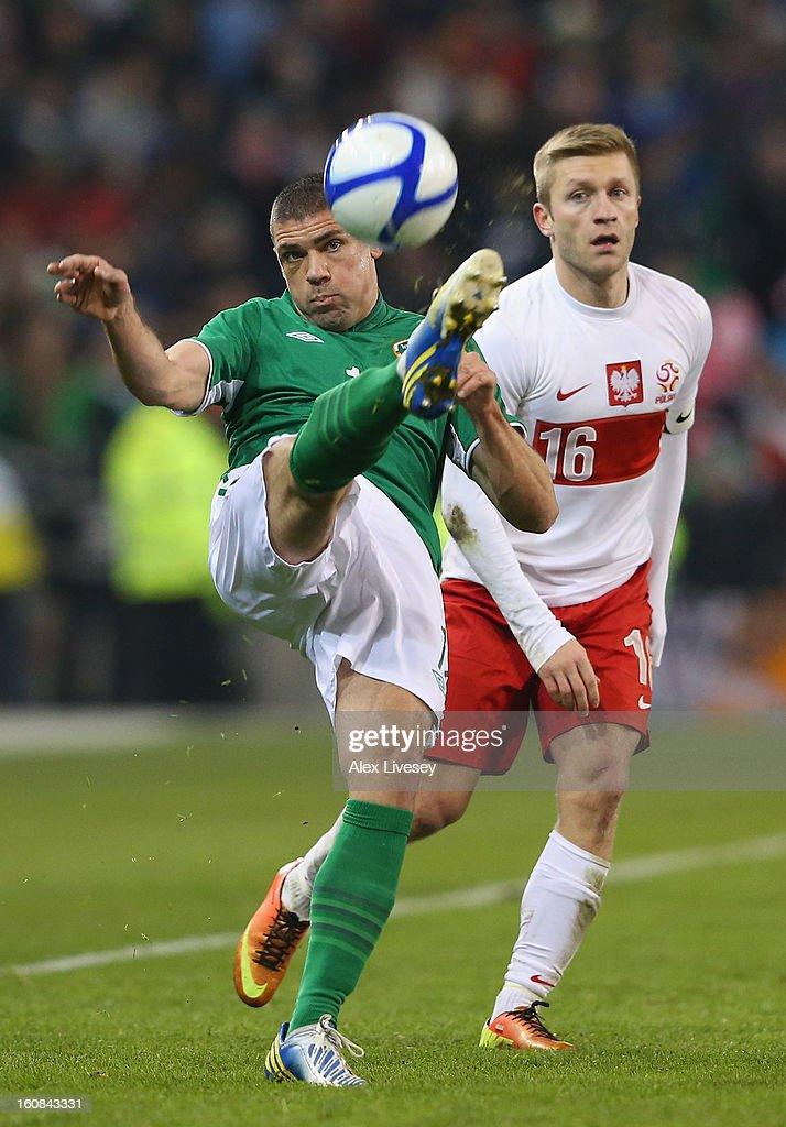 Jon Walters of Republic of Ireland clears the ball under pressure from Jakub Blaszczykowski of Poland during the International Friendly match between Republic of Ireland and Poland at Aviva Stadium on February 6, 2013 in Dublin, Ireland.