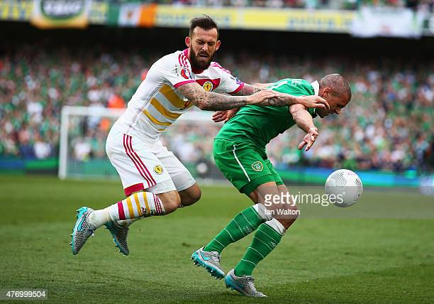 Jon Walters of Republic of Ireland is challenged by Steven Fletcher of Scotland during the UEFA EURO 2016 Qualifier Group D match between Republic of...