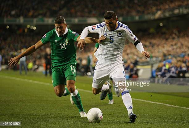 Jon Walters of the Republic of Ireland and Sead Kolasinac of Bosnia and Herzegovina compete for the ball during the UEFA EURO 2016 Qualifier play off...