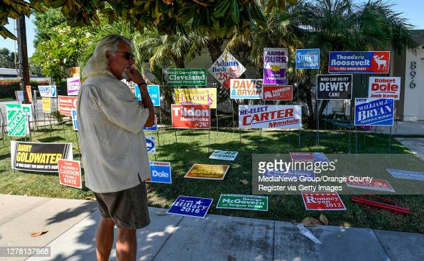 Jon Webb keeps an eye on a political art installation being installed on his front lawn in Orange, California on October 2, 2020. The display titled,...