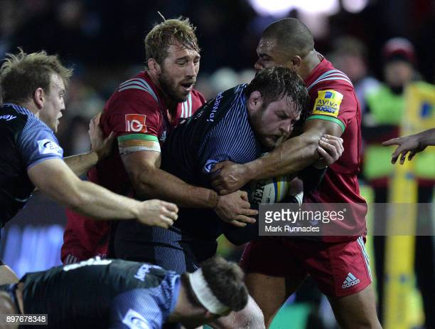 Jon welsh of Newcastle Falcons is tackled by Kyle Sinckler and Chris Robshaw of Harlequins during the Aviva Premiership match between Newcastle...