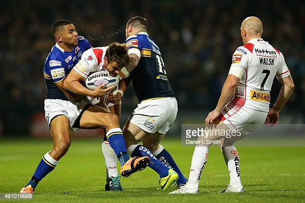 Jon Wilkin of St Helens RFC collides in a tackle from Brett Delaney and Ryan Hall of Leeds Rhinos during the First Utility Super League Semi Final...