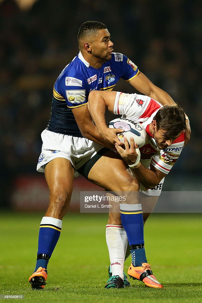 Jon Wilkin (c) of St. Helens R.F.C is held by Ryan Hall of Leeds Rhinos during the First Utility Super League Semi Final between Leeds Rhinos and St Helens at Headingley Carnegie Stadium on October 2, 2015 in Leeds, England.