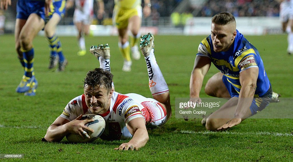 Jon Wilkin of St Helens scores a first hlaf try past Matty Russell of Warrington Wolves during the First Utility Super League match between St Helens and Warrington Wolves at Langtree Park on March 19, 2015 in St Helens, England.