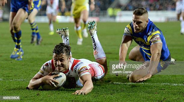 Jon Wilkin of St Helens scores a first hlaf try past Matty Russell of Warrington Wolves during the First Utility Super League match between St Helens...