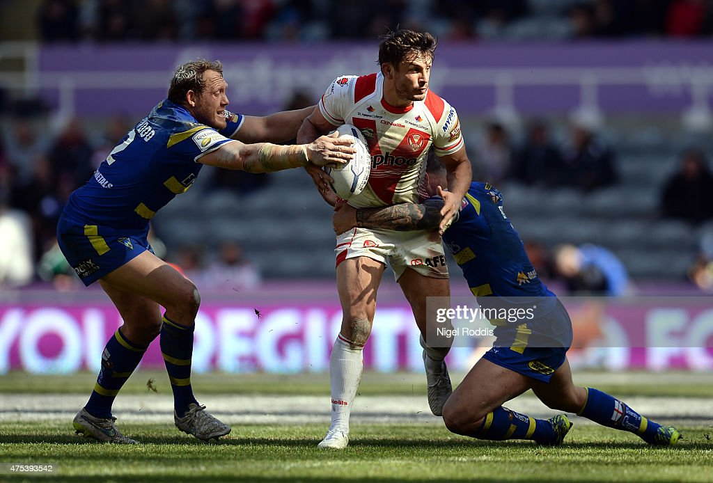 Jon Wilkin (C) of St Helens tackled by Ben Westwood (L) and Chris Bridge of Warrington Wolves during the Super League match between St Helens and Warrington Wolves at St James' Park on May 31, 2015 in Newcastle upon Tyne, England.