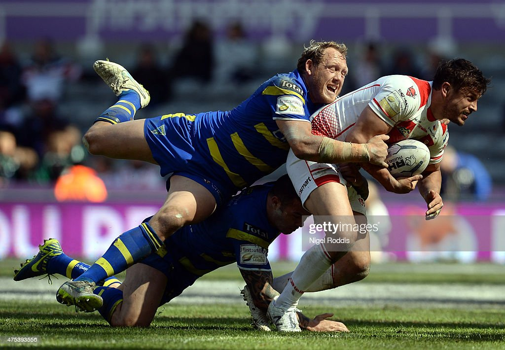 Jon Wilkin (R) of St Helens tackled by Ben Westwood (L) and Chris Bridge of Warrington Wolves during the Super League match between St Helens and Warrington Wolves at St James' Park on May 31, 2015 in Newcastle upon Tyne, England.