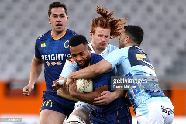 Jona Nareki of Otago is tackled by Jack Debreczeni of Northland during the round four Mitre 10 Cup match between Otago and Northland at Forsyth Barr...