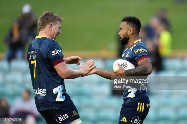 Jona Nareki of the Highlanders celebrates scoring a try during the round three Super Rugby Trans-Tasman match between the Highlanders and the...