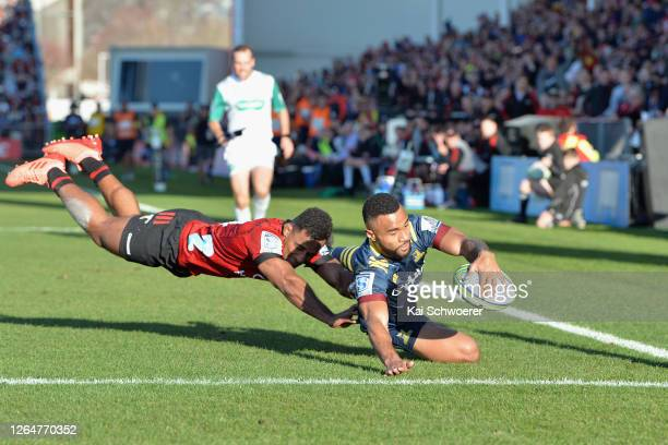 Jona Nareki of the Highlanders dives over to score a try during the round 9 Super Rugby Aotearoa match between the Crusaders and the Highlanders at...