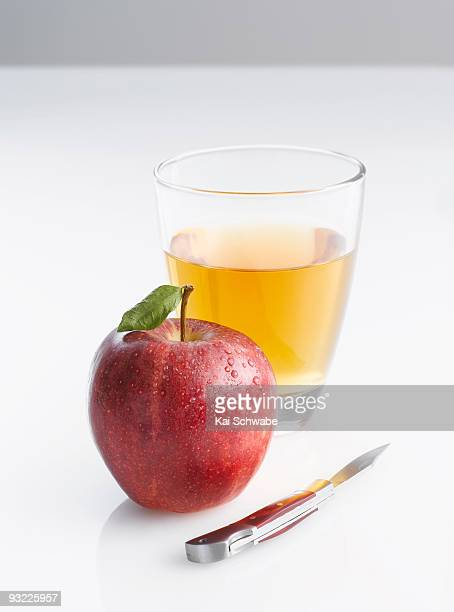 Jonagold apple, knife and glass of apple juice