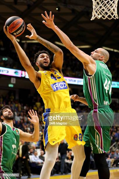 Jonah Bolden #43 of Maccabi Fox Tel Aviv competes with James Augustine #40 of Unicaja Malaga during the 2017/2018 Turkish Airlines EuroLeague Regular...