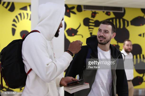Jonah Bolden and Chris Goulding of the Boomers chat after arriving at Perth Airport on August 12, 2019 in Perth, Australia.