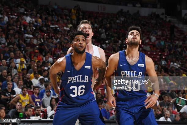 Jonah Bolden and Furkan Korkmaz of the Philadelphia 76ers box out against the Los Angeles Lakers during the 2018 Las Vegas Summer League on July 7...