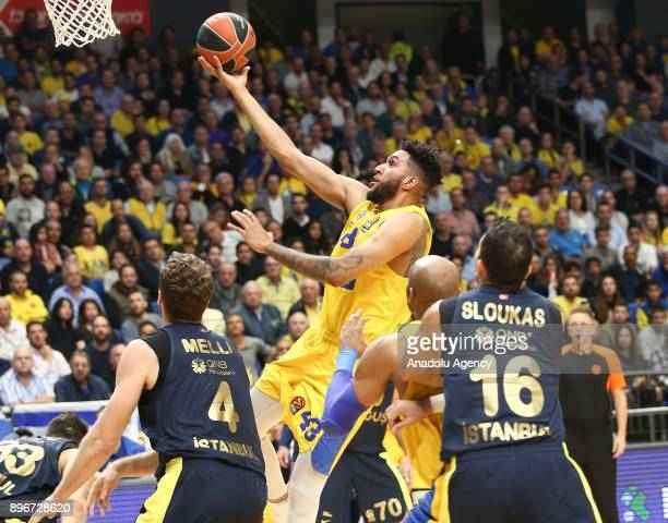 Jonah Bolden of Maccabi Fox Tel Aviv in action against Nicolo Melli and Kostas Sloukas of Fenerbahce Dogus during Turkish Airlines Euroleague match...