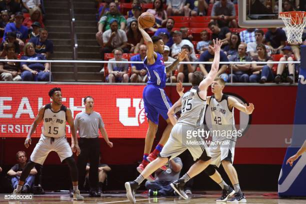 Jonah Bolden of the Philadelphia 76ers drives to the basket and passes the ball during the 2017 Utah Summer League game against the Utah Jazz on July...