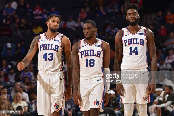 Jonah Bolden Shake Milton and Norvel Pelle of the Philadelphia 76ers look on during a preseason game against the Washington Wizards on October 18...
