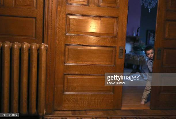 FALLS ON OCTOBER 14 Jonah Boyle looks out from a pocket door Joshua Boyle's children in their grandparents home after arriving back in Canada after...