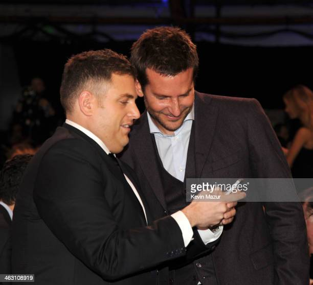 Jonah Hill and Bradley Cooper attend the19th Annual Critics' Choice Movie Awards at Barker Hangar on January 16 2014 in Santa Monica California