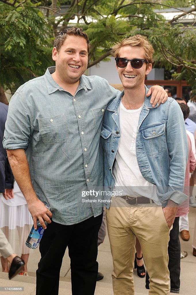 Jonah Hill and Max Winkler attend LAXART 2013 Garden Party on July 21, 2013 in Los Angeles, California.