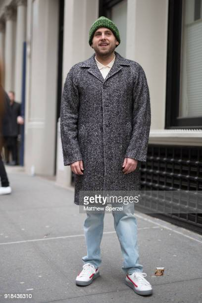 Jonah Hill is seen on the street attending EDUN during New York Fashion Week wearing a grey wool coat with green beanie on February 14 2018 in New...