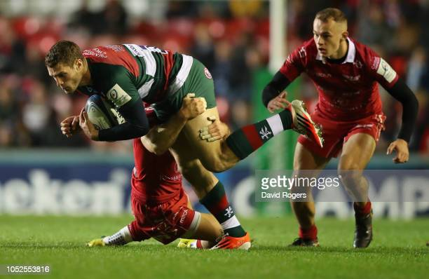 Jonah Holmes of Leicester Tigers is tackled during the Champions Cup match between Leicester Tigers and Scarlets at Welford Road Stadium on October...