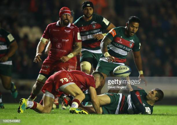 Jonah Holmes of Leicester Tigers off loads the ball during the Champions Cup match between Leicester Tigers and Scarlets at Welford Road Stadium on...