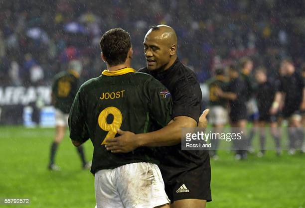 Jonah Lomu embraces Joost van deer Westhuizen after the All Blacks 123 win over the Springboks in the first TriNations rugby test at Newlands Stadium...