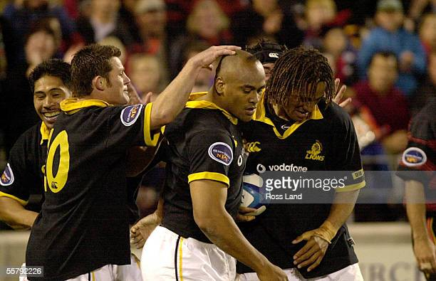 Jonah Lomu is congratulated on scoring his second try by David Holwell , Alama Ieremia and Kupu Vanisi, during the Air New Zealand NPC first division...