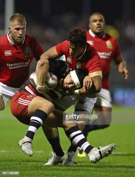 Jonah Lowe of NZ Provincial Barbarians is tackled by Anthony Watson of the British Irish Lions during the 2017 British Irish Lions tour match between...
