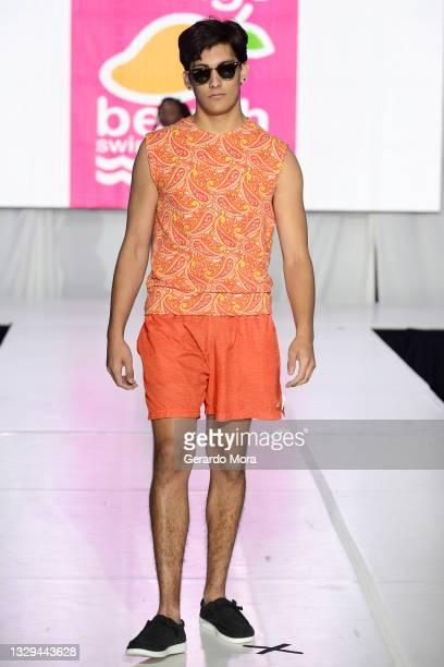 Jonah Manzi walks the runway for Mango Beach Swimwear during Orlando Swim Week Powered By hiTechMODA on July 18, 2021 in Orlando, Florida.