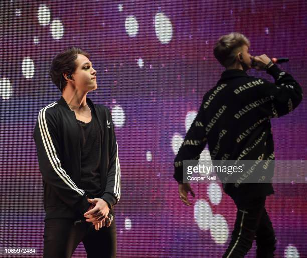 Jonah Marais and Corbyn Besson of Why Don't We perform onstage during 1061 KISS FM's Jingle Ball 2018 at American Airlines Center on November 27 2018...
