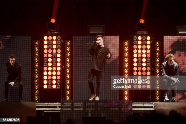 Jonah Marais Daniel Seavey and Jack Avery of Why Don't We perform onstage at 1061 KISS FM's Jingle Ball 2017 Presented by Capital One at American...