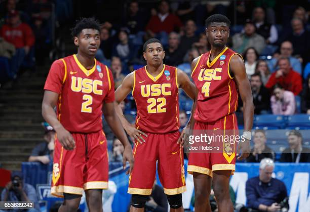 Jonah Mathews De'Anthony Melton and Chimezie Metu of the USC Trojans look on in the second half against the Providence Friars during the First Four...