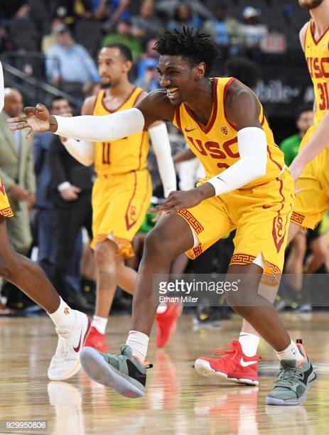Jonah Mathews of the USC Trojans celebrates on the court after teammate Elijah Stewart hit a 3-pointer against the Oregon Ducks during a semifinal...