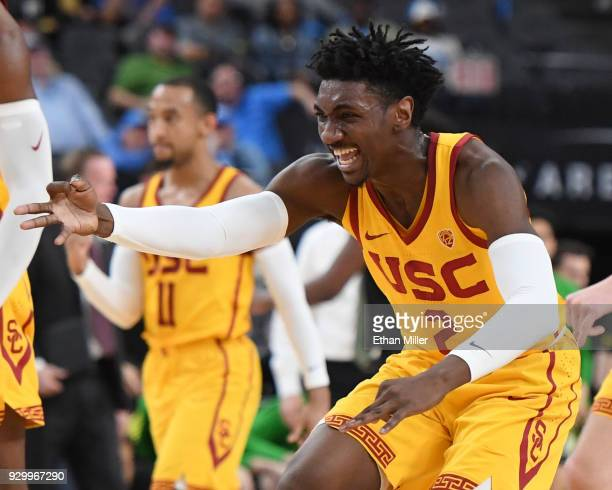 Jonah Mathews of the USC Trojans celebrates on the court after teammate Elijah Stewart hit a 3pointer against the Oregon Ducks during a semifinal...