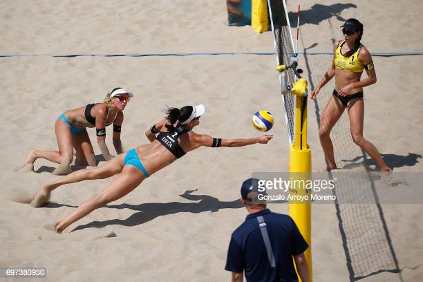 Jonana Heidrich from Switzerland tries to save the ball ahead her partner Anouk VergeDepre as Maria Antonelli from Brazil observes them during their...
