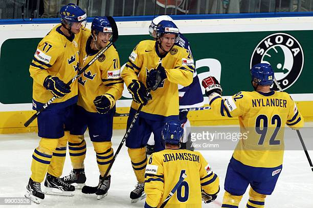 Jonas Andersson of Sweden celebrates his team's second goal with team mates during the IIHF World Championship group C match between Sweden and...